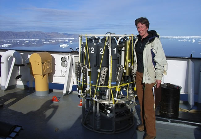 Dr Berit Rabe on board Canadian Coast Guard Ship Henry Larsen in Nares Strait, next to her favourite instruments that can measure temperature, conductivity, pressure, and take water samples.