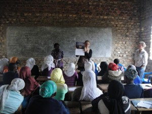 Telling the Ugandan class how the ScienceGrrl calendar was created.