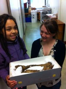 Tori and Aimee looking at fossils